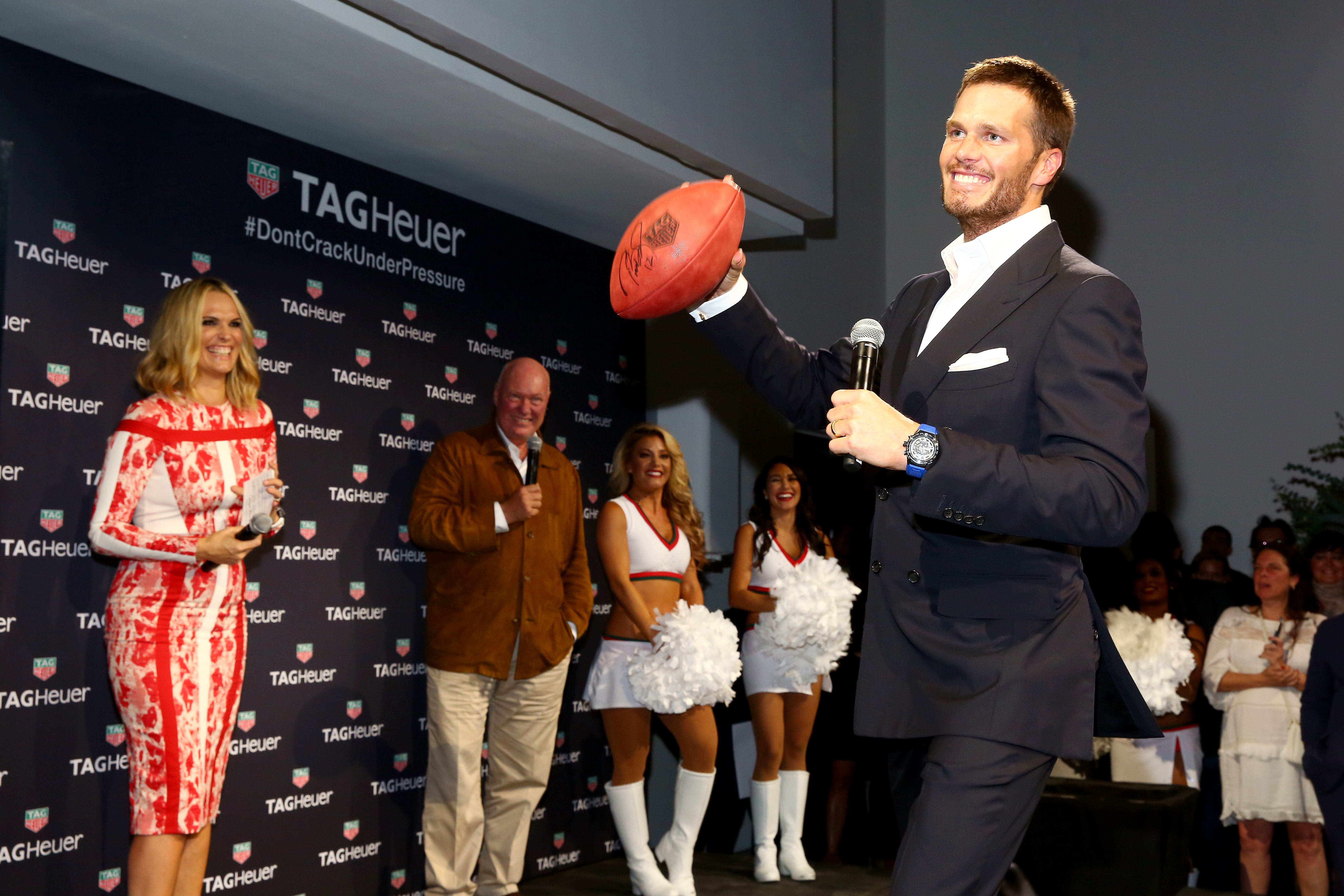 NEW YORK, NY - OCTOBER 13: (L-R) Molly Sims, Jean-Claude Biver and Tom Brady appear on stage as TAG Heuer announces Tom Brady as the new brand ambassador and launches the new Carrera - Heuer 01 on October 13, 2015 in New York City. (Photo by Astrid Stawiarz/Getty Images for TAG Heuer)